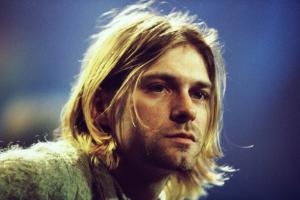 """İntihar eden en ünlü figürlerden Kurt Cobain kitapta biraz hırpalanmış.  """"Doğrusunu söylemek gerekirse, denyonun teki. Yani, ben de çok memnun değilim bulunduğum yerden, ama bu herif şikayet etmeye başladı mı sonu gelmiyor""""."""