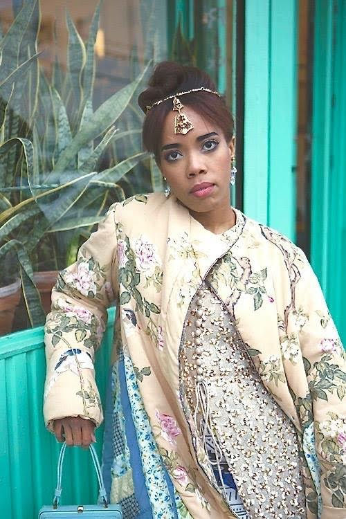 "Floral ""comforter coat"" designed by Pratt Fashion graduate Lauren Nahigian (BFA '15); late 60s/early 70s Lee Jordan gold sequin robe, Ahab Bowen, Dallas, TX; 80s ""highlighter"" tribal print body con dress from vendor at Artists and Fleas, Williamsburg, Brooklyn; powder blue leather handbag from 1 of a Find Vintage, Brooklyn; heirloom crystal earrings; vintage brutalist gold necklace (worn as a headpiece) from 1 of a Find Vintage, Brooklyn; Photo Credit: Guang Xu"