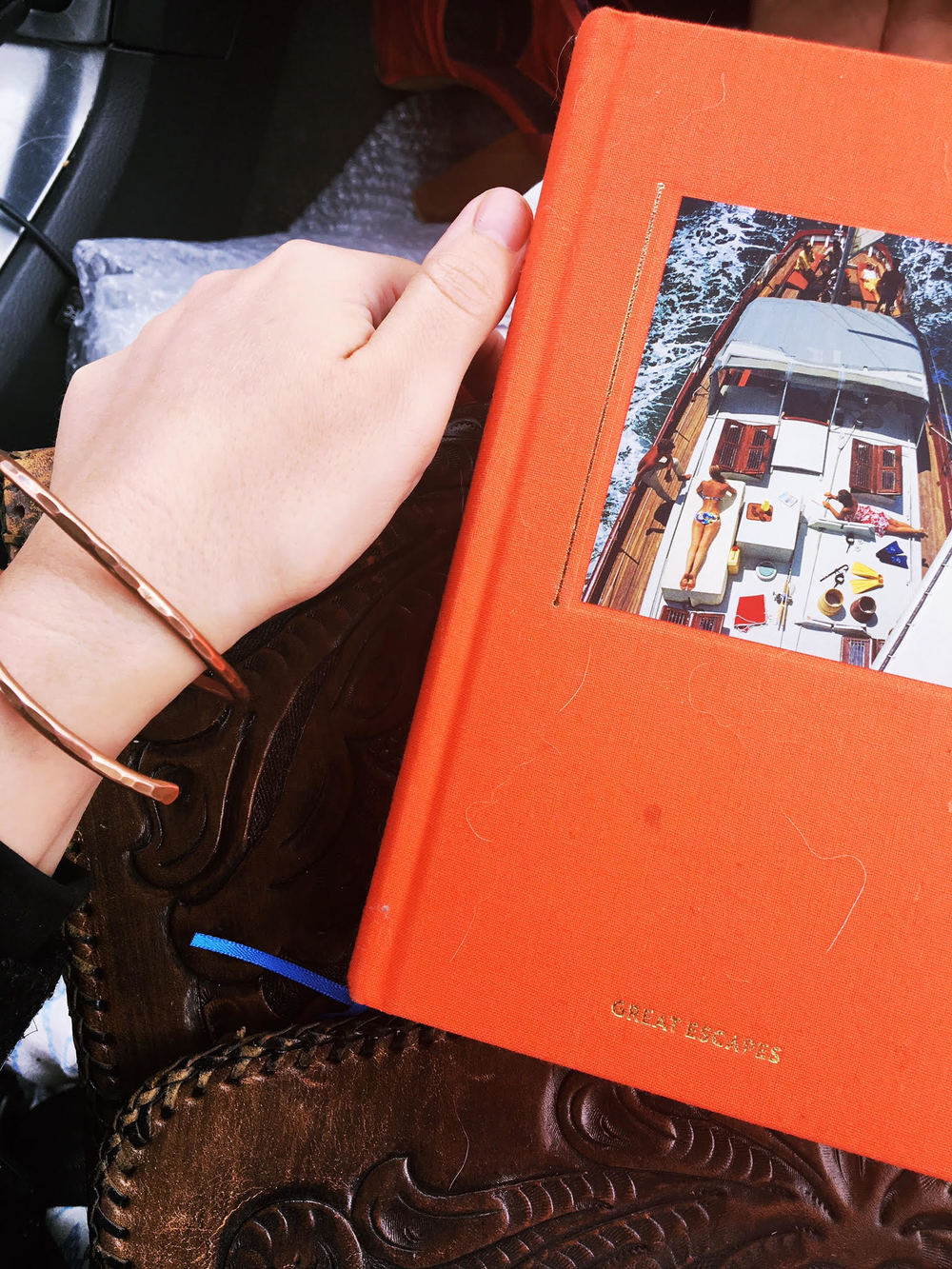 Travel Essentials: Journal, Camera, Simon & Ruby pieces.