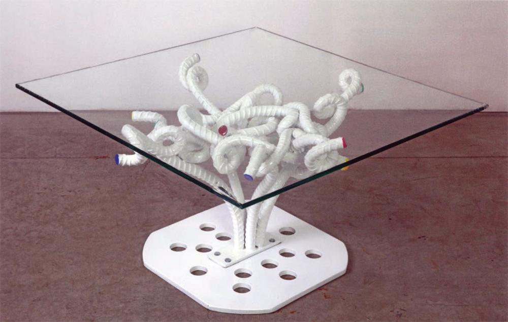 Table with intertwined steel base