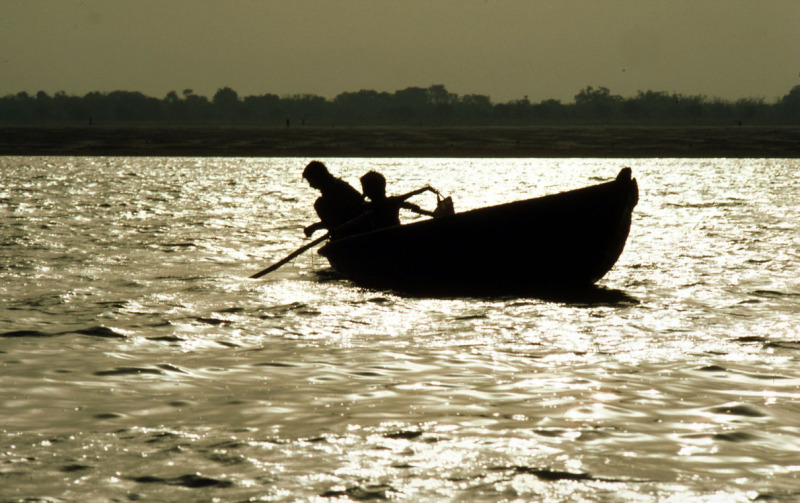 Young boys fishing on the Ganges river. Varanasi, Uttar Pradesh. India