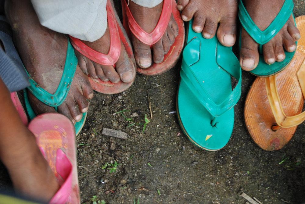 Sandals of Malagasy children in Bealanana, Madagascar © WWF / Martina Lippuner