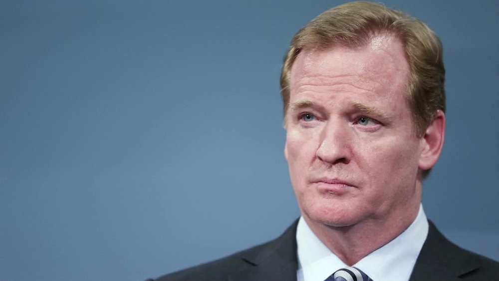 Roger Goodell addresses the press as he announces the NFL will no longer require human players or officials.