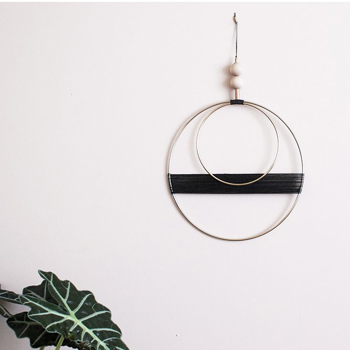 DOUBLE CIRCLE WITH CHARCOAL THREAD HANGING