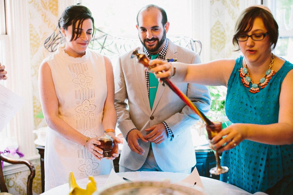 Extinguishing Havdalah Candle Hertzberts Wedding.jpg