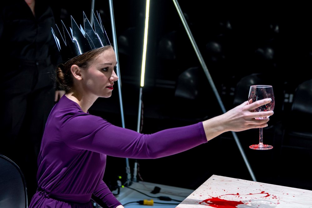 Lady Macbeth (Shelby Lewis), featuring her crown (prop by Lyssa Troemel), gorgeous purple queen dress (costumed by Brooke O'Mara), with some rad blood on that table (made by Tara Olivero).