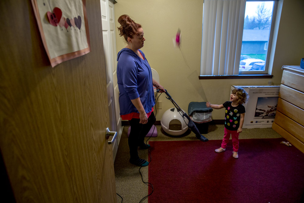 "Sarah vacuums the room that she's devoted to her new cat, a pet she said that helps her stay away from smoking, as Suzanna begins swinging one of the cat toys wildly. ""Don't hit me or the cat with that,"" Sarah says in a worn but stern voice."