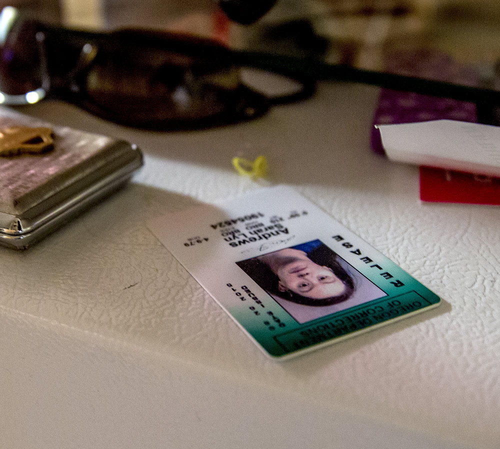 Sarah's prison release card sits out of site atop her refrigerator which she forgot about amidst the daily tasks work, school, and taking care of her daughter.