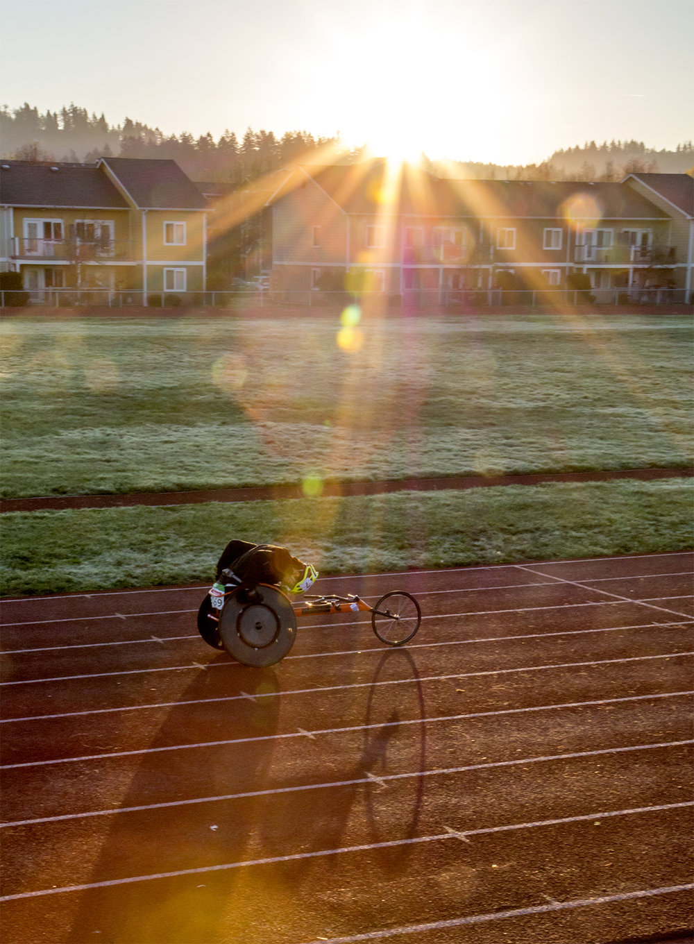 The sun rises above the South Eugene Eugene High School track, a light dusting of frost covers the grass in the early morning, and John Robert steadily grinds away at his workout with his head down. Roberts has been a para-athlete since he was 12 years old. His racing team has taken him to such places as the worlds championships in New Zealand to the Olympic games in Rio. The South Eugene Track is both a nearby place to train and a reminder of his time attending South Eugene High School