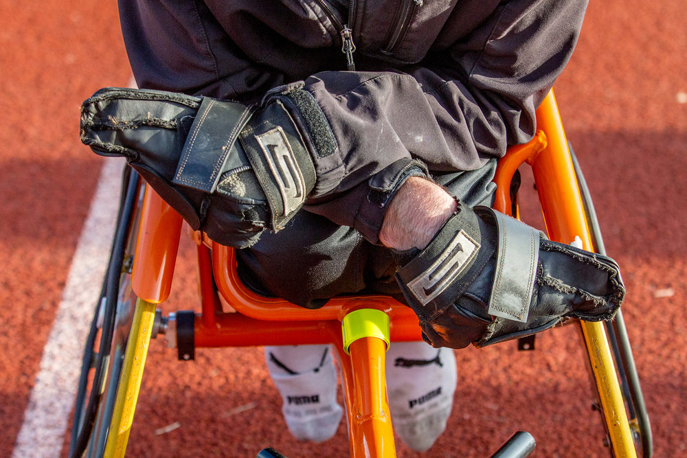 Parathletes use specialized gloves that are rough along the palm side to push the bars of their rear wheel forward.