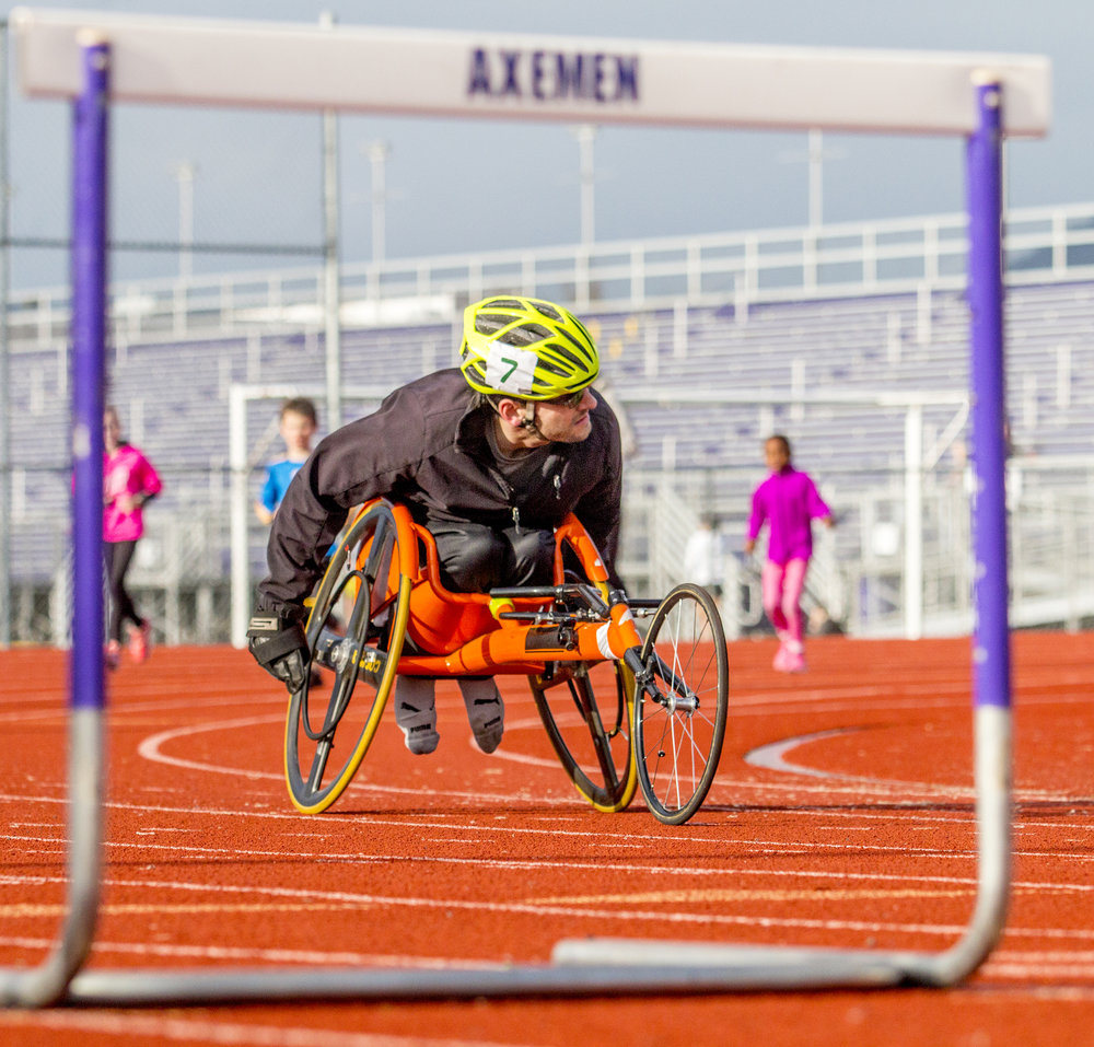 John rounds the corner of the South Eugene High School track. When he attended South Eugene as a student he would race around the track. Now as an adult he still prefers to train on the track, sometimes alongside current South Eugene students.