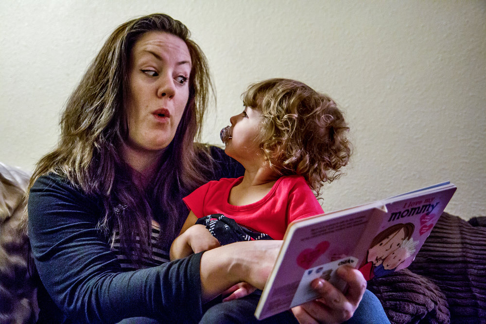 Sarah reads to Suzanna before bed, acting out faces to match the story. While the learning curve was steep, she now knows she was meant to be a mother.