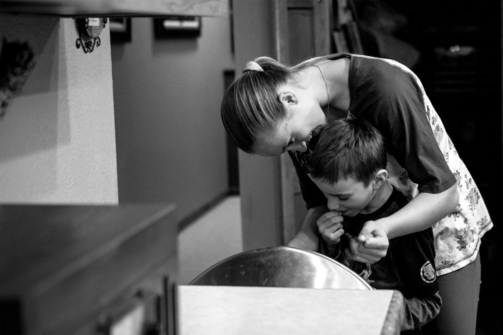 """Talon Pfeil watches her brother Sasha crack peanut shells over the trash can on Wednesday, Jan. 9, 2019. """"When they're here, we get so close to them. I don't want to see them leave,"""" Talon says."""
