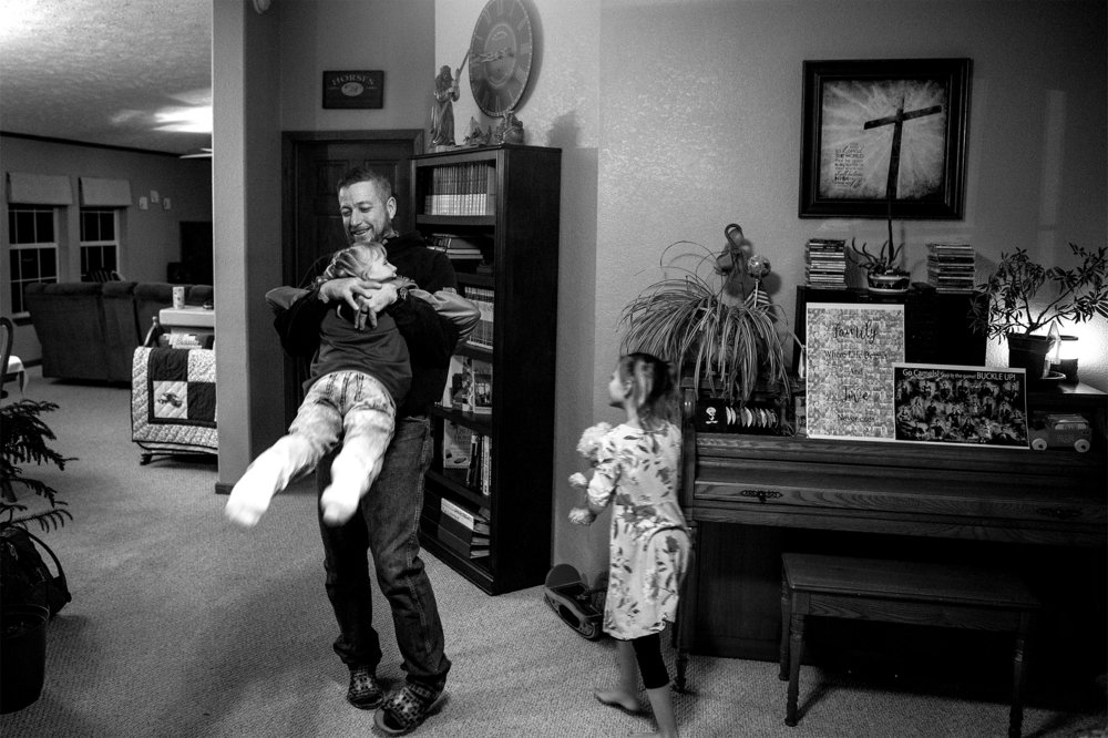 """Derrick Mitchell spins Natalia around during a family get-together on Wednesday, Jan. 9, 2019. After Derrick's youngest graduated high school he and his wife thought they were done. """"Now we're getting ready to do it all over again,"""" Derrick says."""