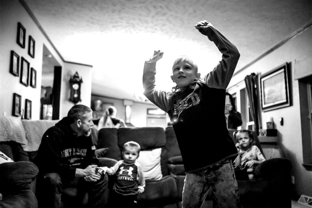 Natalia plays a dance game on the Xbox Kinect during a get-together with the Pfeil family on Wednesday, Jan. 9, 2019. The four weeks begin with smiles and end with tears. If all goes well and both parties say yes, soon the orphans will be able to call Gillette their homes.