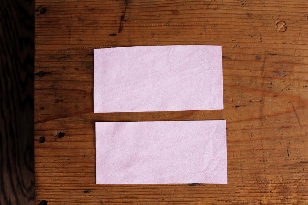 1) Cut the fabric piece in half