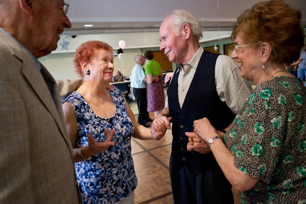 Klaus Wesenberg and his wife, Trudy, congratulate Joyce and Frank on their engagement during the Senior Sock Hop at the Greece Community and Senior Center.