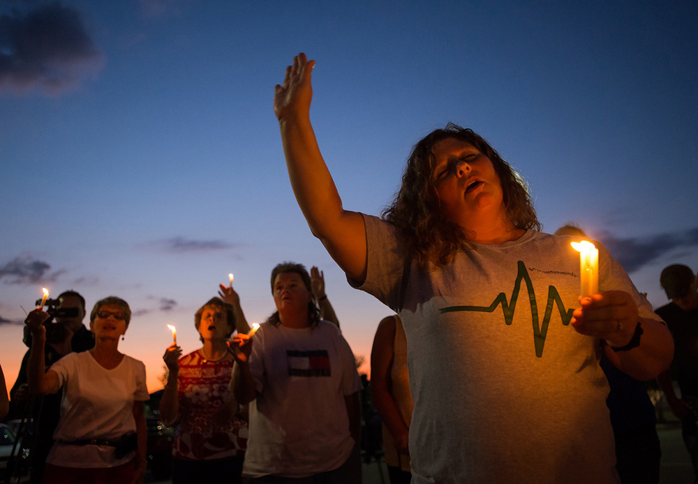 Stephanie Gray attends a vigil for reporter Alison Parker and cameraman Adam Ward, who were shot to death during a live broadcast at Bridgewater Plaza in Moneta, Va.