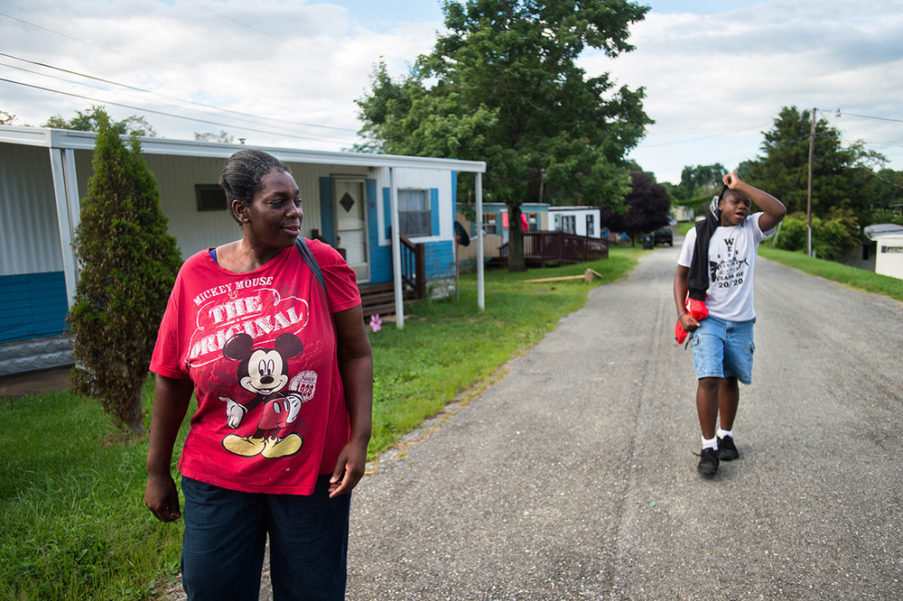 Ruby and her son walk to the bus stop from their home in Brentwood Mobile Home Park. Ruby cannot afford a car, so she uses the bus as her main source of transportation.