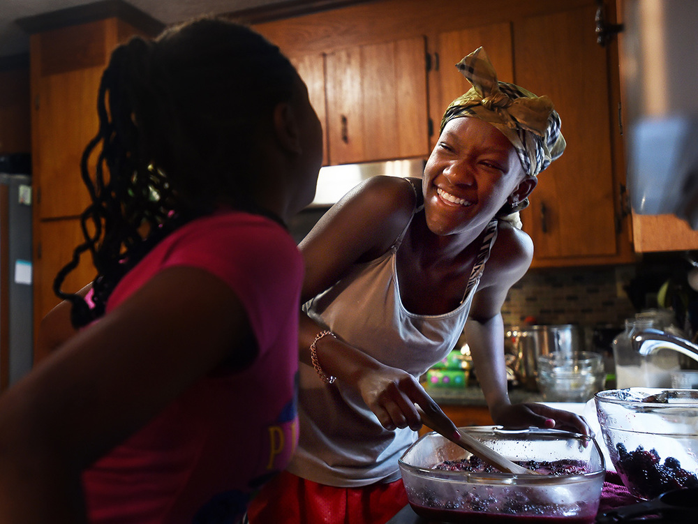 Promise and Sahara share a laugh while preparing blackberry cobbler with fresh berries they picked earlier that morning at Morris Orchard.