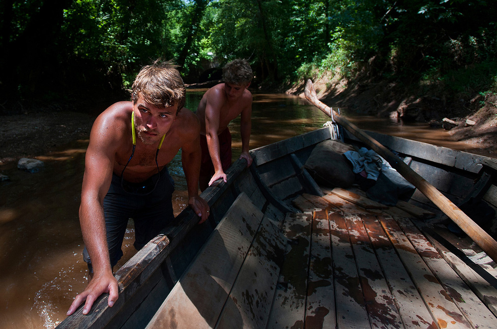Andrew Shaw and Tim Morton push the Mary Marshall into deeper water after they took a detour in a tributary of the James River.
