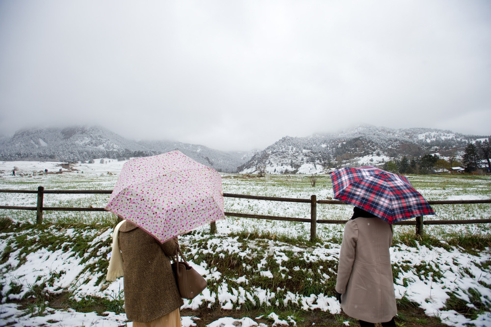 Lek Jirangpitakkul (left) and Oum Jirangpitakkul take in the view of the snow covered foothills at Chautauqua Park in Boulder, Colo.