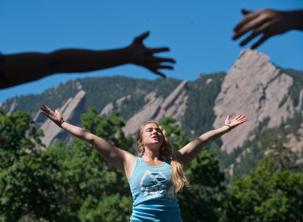 Renee Rodgers, an instructor with Everest Healing Yoga, leads a yoga class at Chautauqua Park in Boulder, Colo.