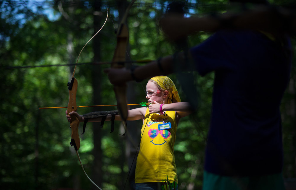 Faith Jacob, 10, shoots an arrow during an archery exercise at Camp Sacajawea in Lynchburg, Va.