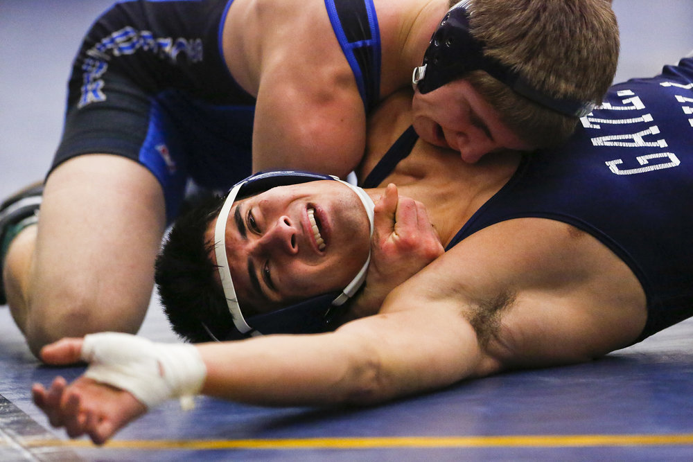 Sam Vacchetto of Webster Schroeder Warriors defeats Christian Ferrante during the quarter finals at the Monroe County League Wrestling Championship in Webster, N.Y.