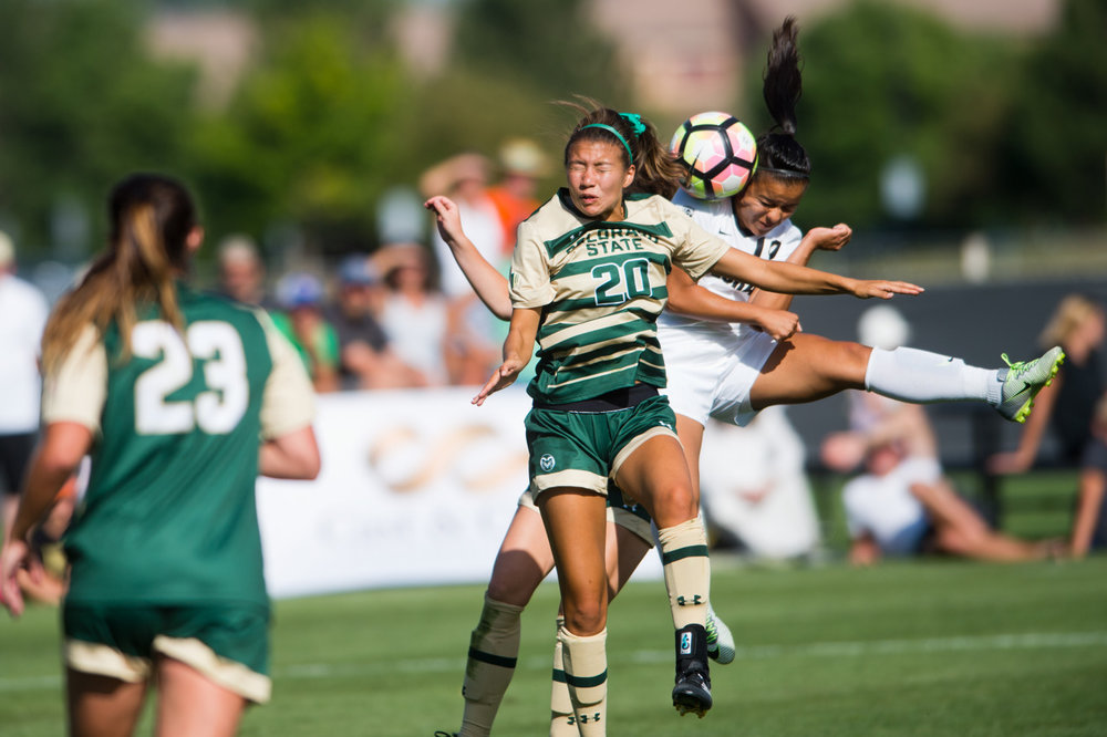 CSU's Janelle Stone and CU's Stephanie Zuniga collide during a head bump at Prentup Field at CU Boulder in Boulder, Colo. CU Boulder defeated CSU 2-1.