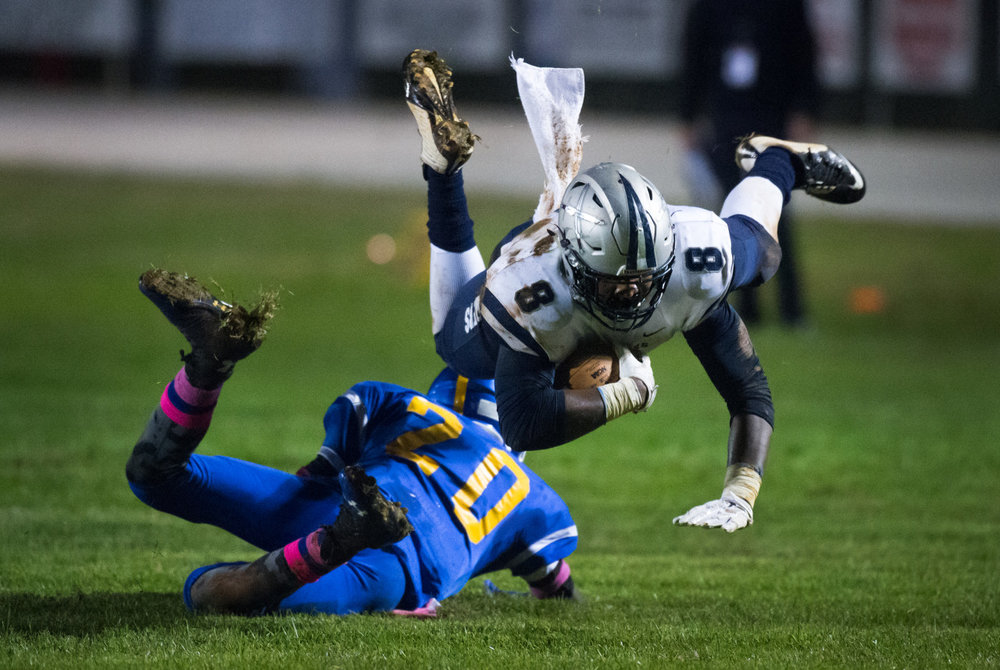 Raiders' Marquise Morgan passes over the Hawks' defensive back Ray Inge during the game at Gretna High School in Gretna, Va. The Appomattox Raiders defeated the Gretna Hawks 34-0.