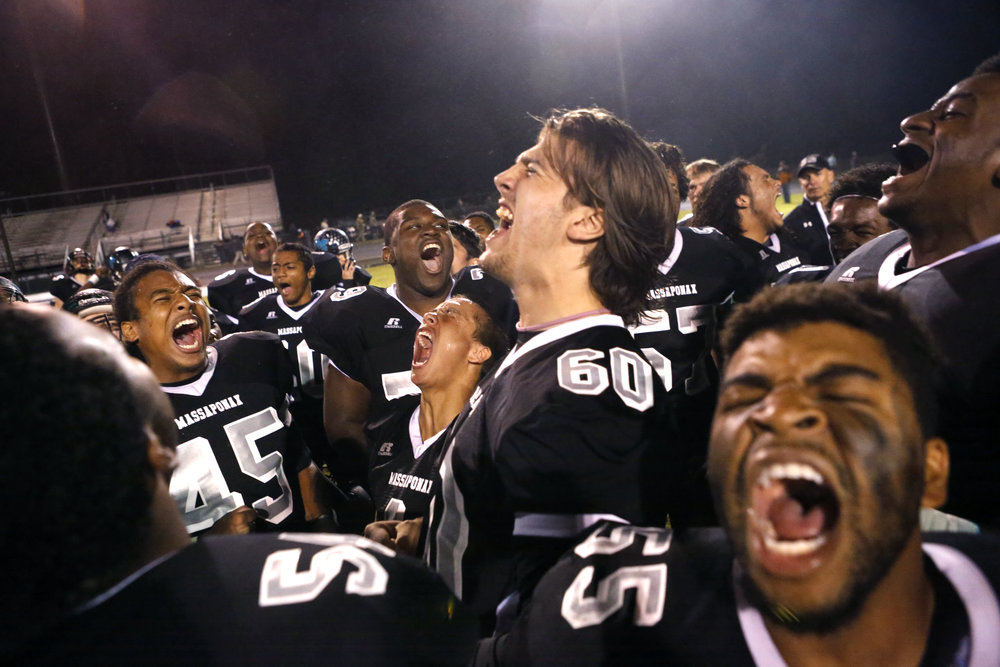 "Massaponax Panthers, from left to right, Robert ""Bo"" Fields, A.J. Forbes, Vinny Mihota and Maliek Legette chant in celebration of their victory against the Mountain View Wildcats' with the rest of their teammates at Massaponax High School in Fredericksburg, Va. The Massaponax Panthers defeated the Mountain View Wildcats 32 - 22."