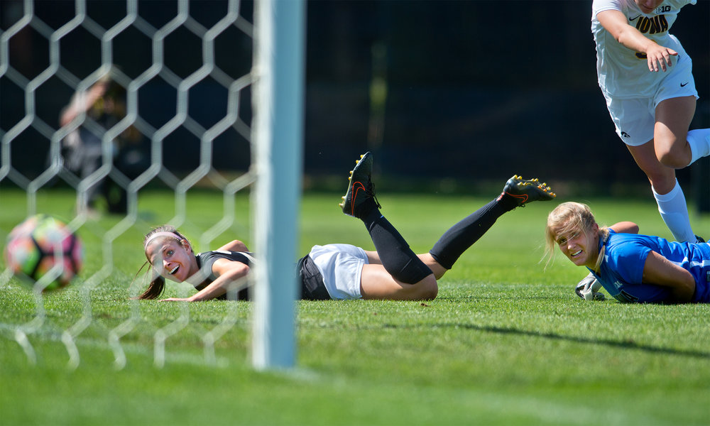 CU's Camilla Shymka (left) and Iowa's goalkeeper, Emma Rigby, watch as the ball rolls into the net during the second half of the game at Prentup Field at CU Boulder in Boulder, Colo. CU defeated Iowa 4-1.