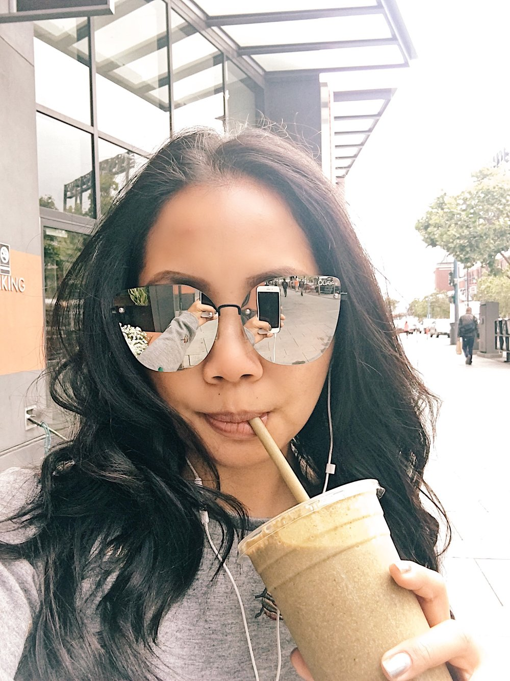 Me sipping on the smoothie from Barry's Bootcamp at the SOMA location
