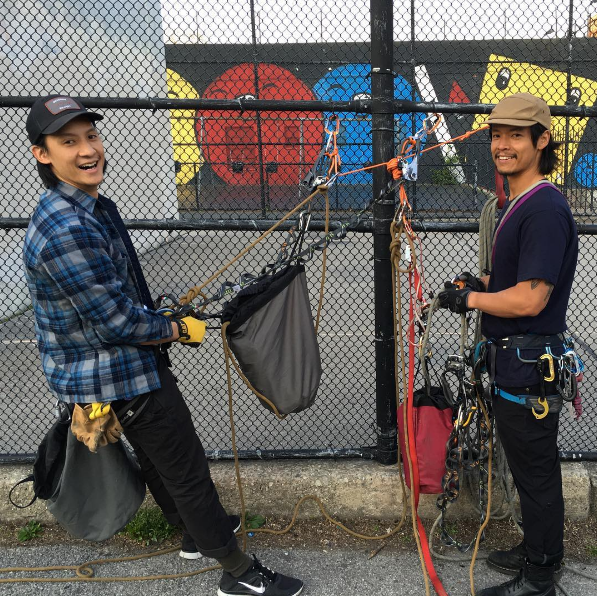 Two handsome men chained to a fence in Brooklyn. Me likey.