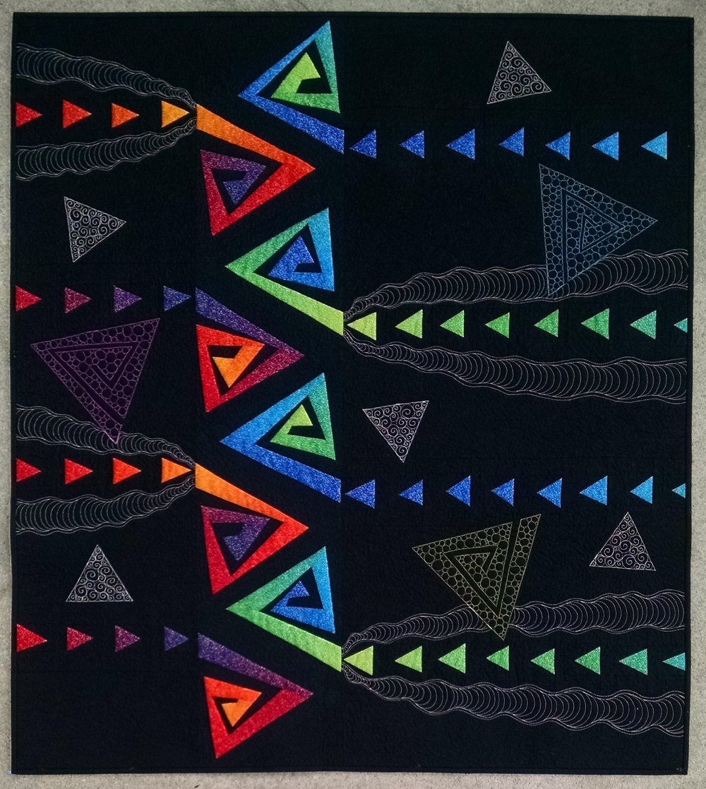 """3. Free Styling, Spiraling & Flying Geese  November 2017 47"""" x 52"""" Improv pieced spirangles sparkle and dance in this modern remake of the traditional flying geese quilt design.  Exhibits/Awards: Juried into Pacific International Quilt Festival (October 2018), awarded 1st Place Modern Quilts for California State Fair (July 2018), juried into Modern Quilt Guild's QuiltCon (February 2018).   Blog Post"""