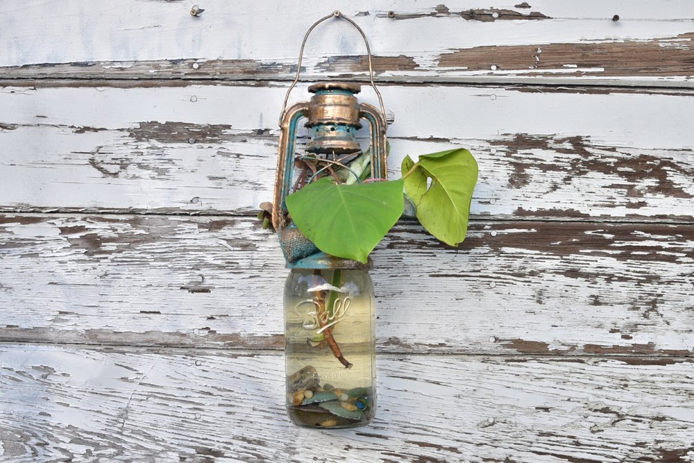"""Illuminate the Inner Circuitry    mason jar planter with river rocks and planted pot in lantern and canvas frame  33"""" x 6"""" x 5"""""""
