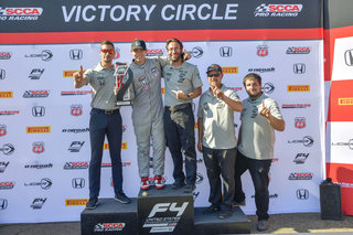 Dakota on the podium with the DC Autosport Crew for their first win together!