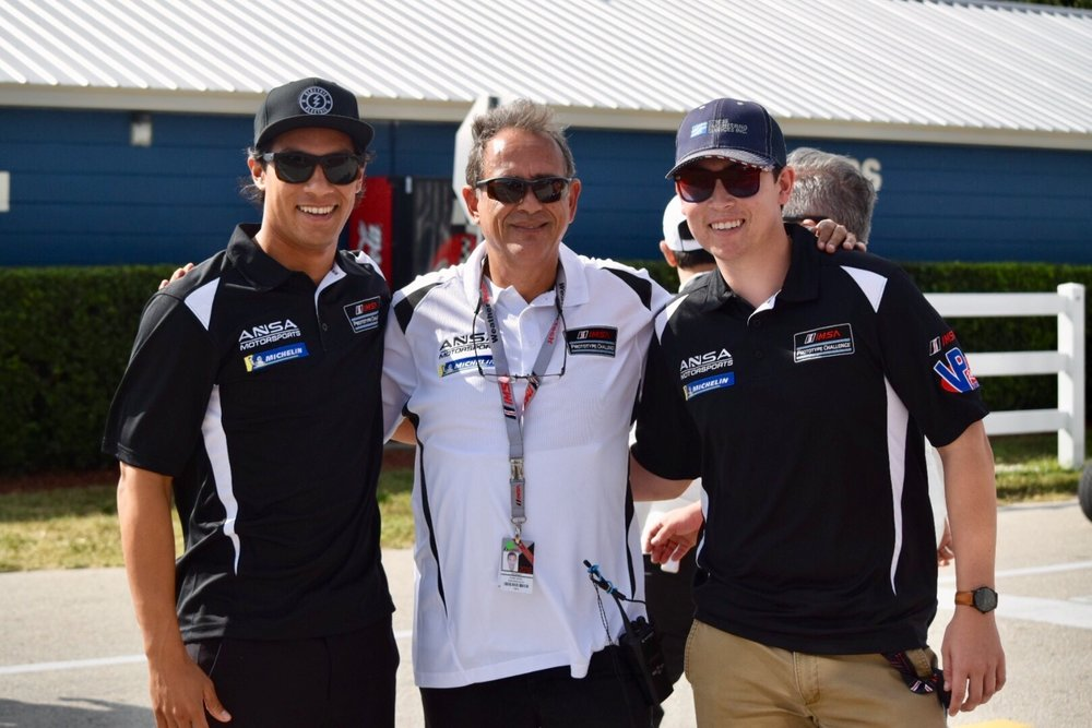 Dickerson (right) with co-driver Neil Alberico (left) and team owner Alain Nadal (center).