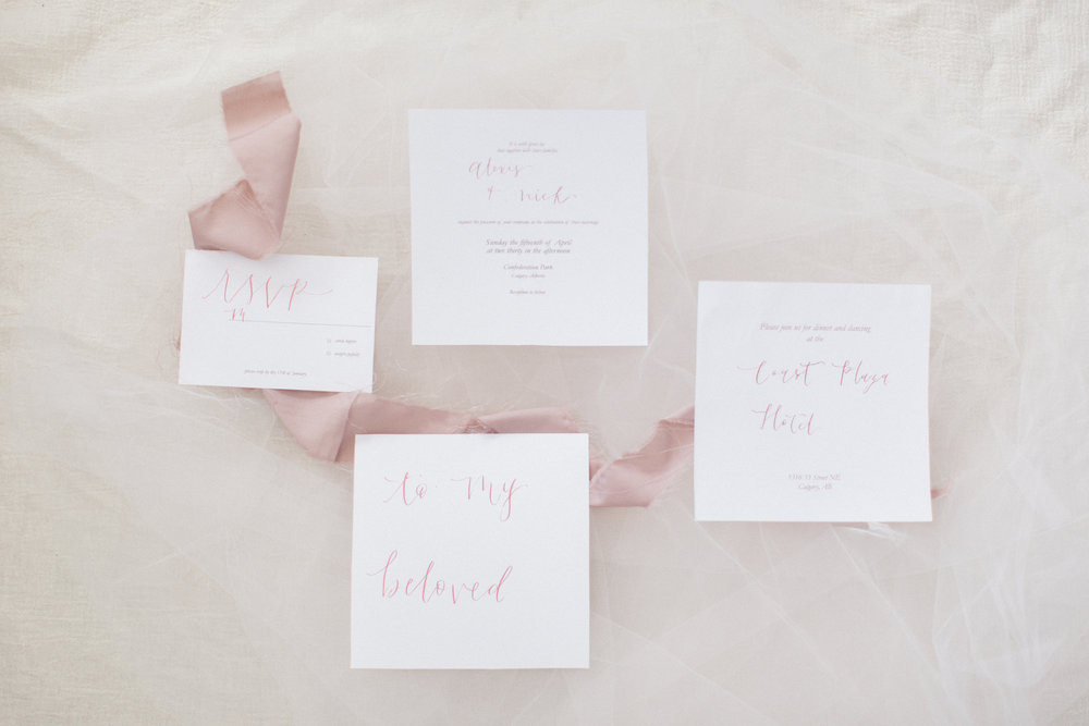 "Simply Beautiful - A twist on the classic invite with a unique square design that makes a memorable mark. This suite includes : -5.7"" x 5.7"" invitation card -3.5"" x 5"" response card *Envelopes and additional paper pieces are not included, but can be added!  *The calligraphy will be done in the spots as shown above - if more is desired, price may be subject to change. *Printing is available at an additional cost - this suite includes the design files only. The final design will be delivered in a PDF format that is ready to be sent to print. Please allow 2-3 weeks for design-only suites, and 4-5 weeks for design and print.  Prices from : $200+"