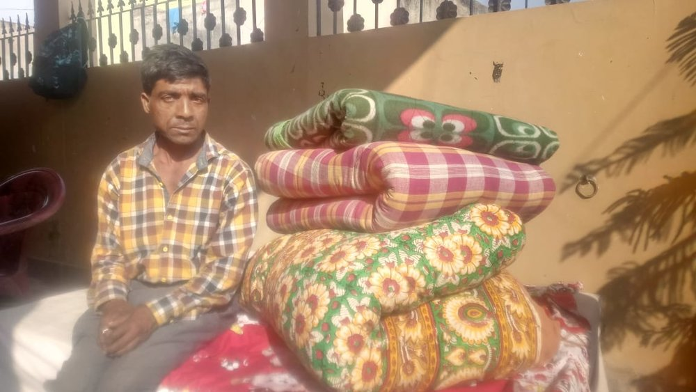 "Deepak at ""Project help India' receiving some blankets and mattresses"