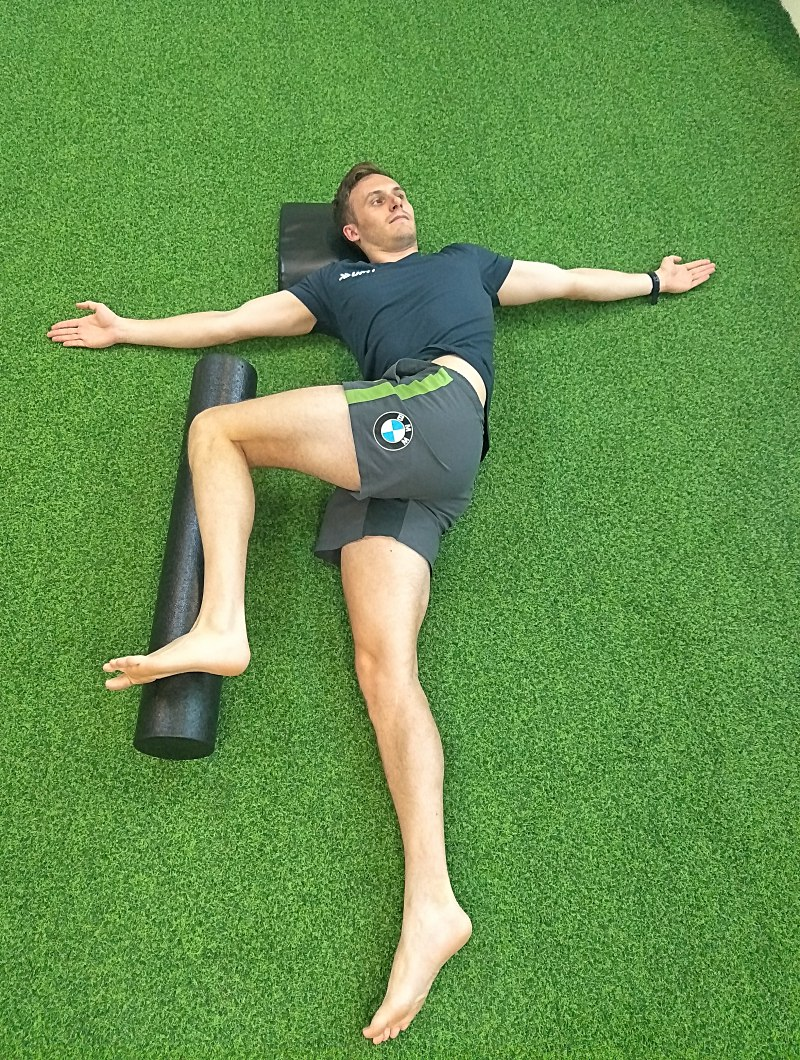 3. Open book upper back rotations with foam roller support.