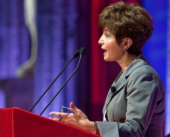 female conference speaker at lectern