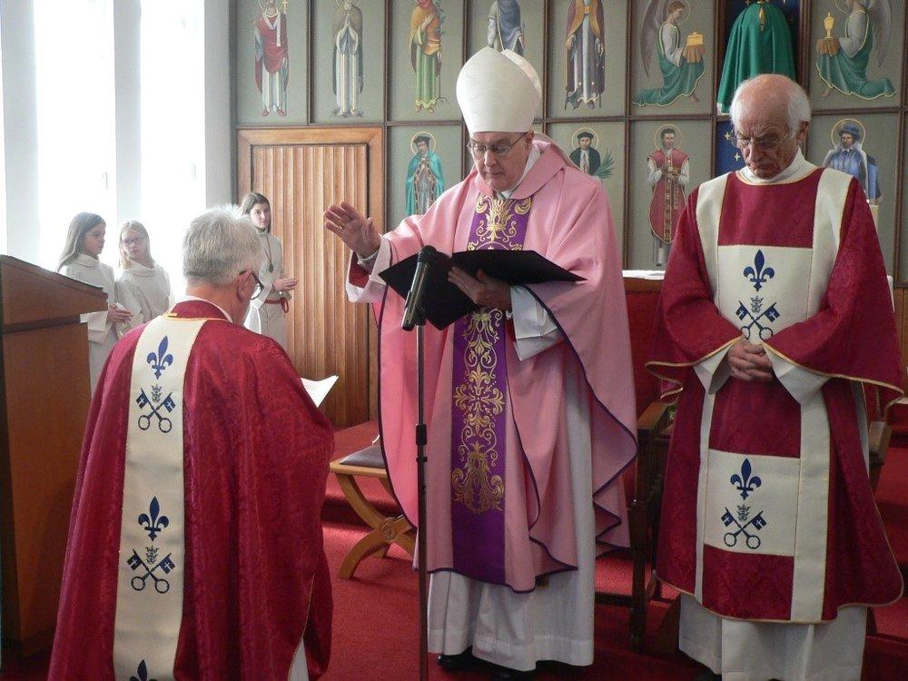 Bishop Blessing Fr P.jpg