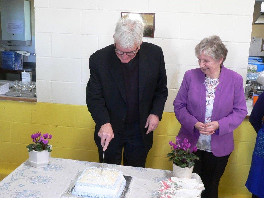 Fr P Cutting Cake.jpg