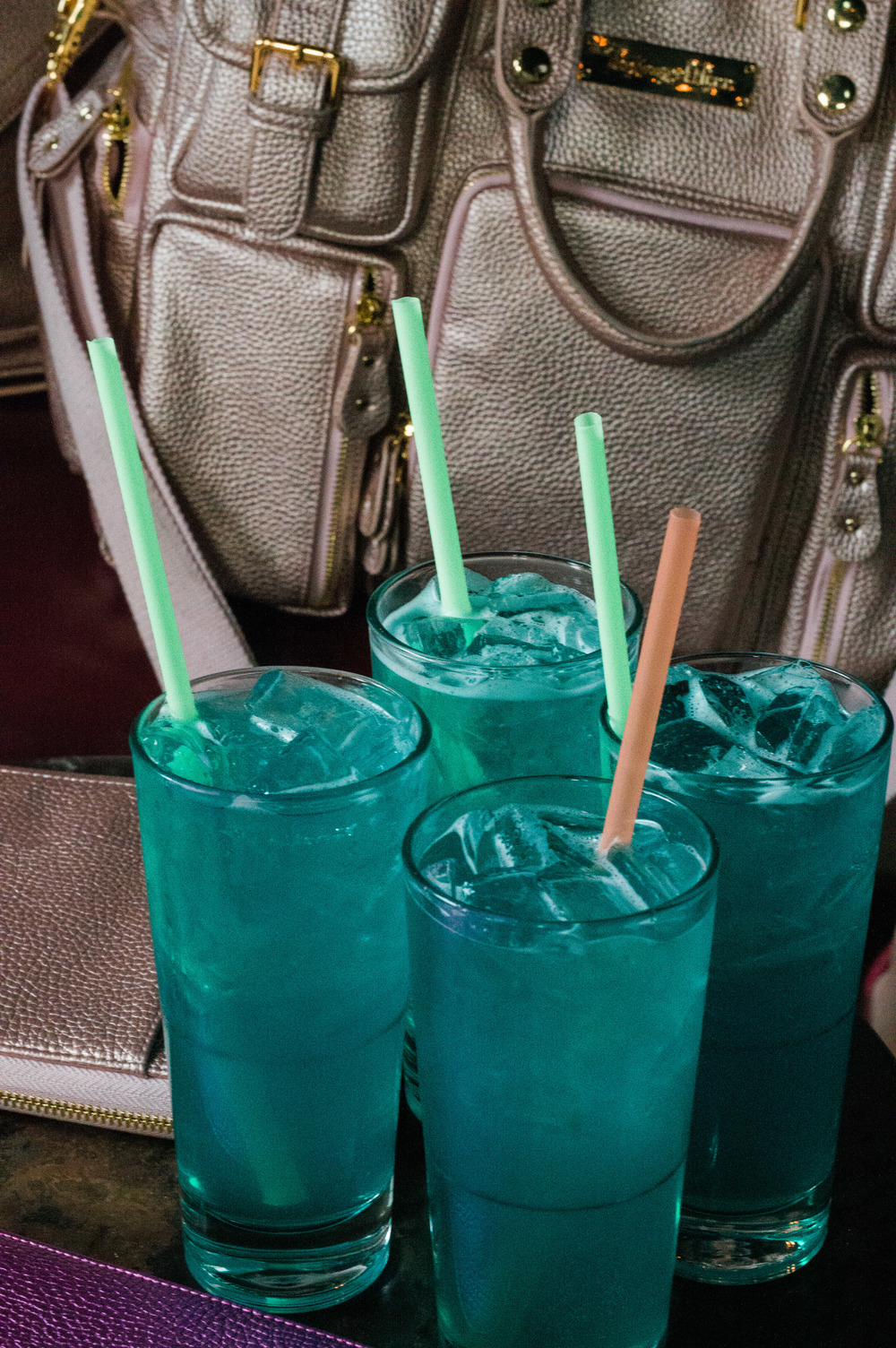 The perfect mermaid style drink, featuring the HOF Travelers Wallets and Evermore.