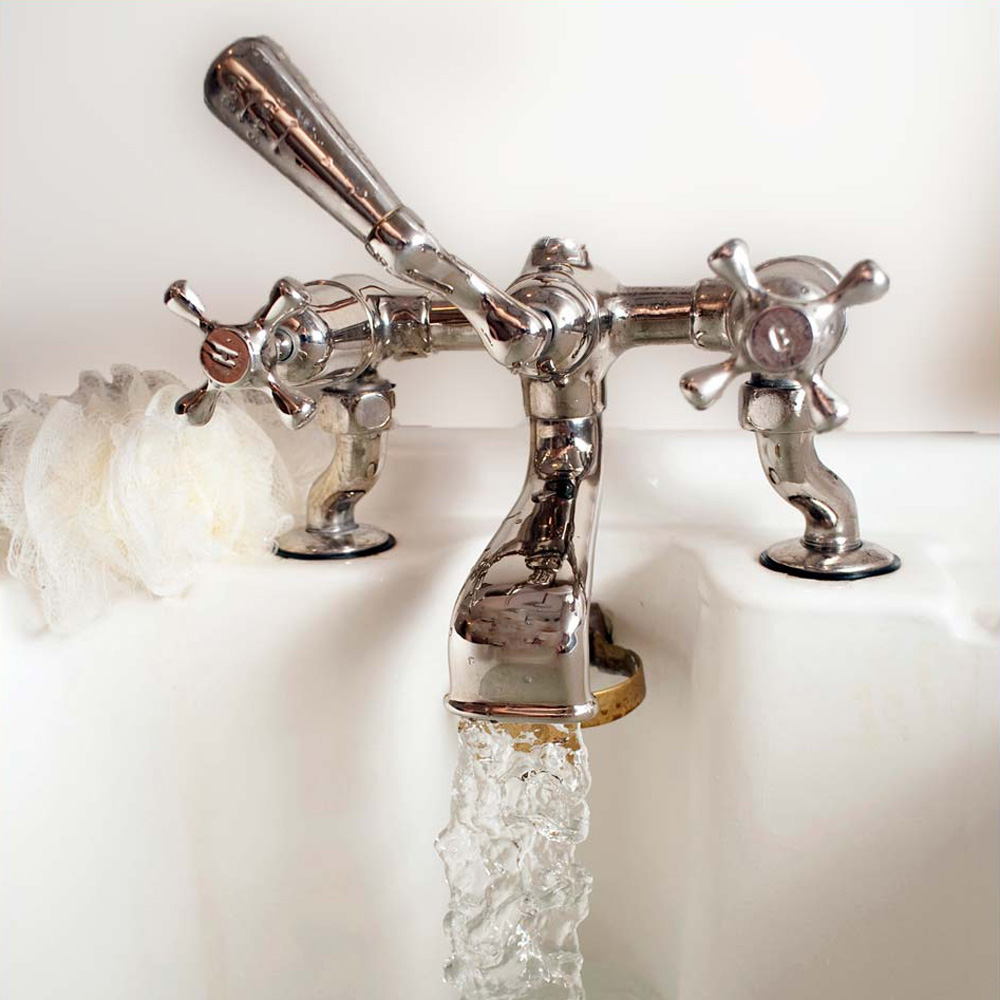 Running bath tap to illustrate plumbing services in Essex