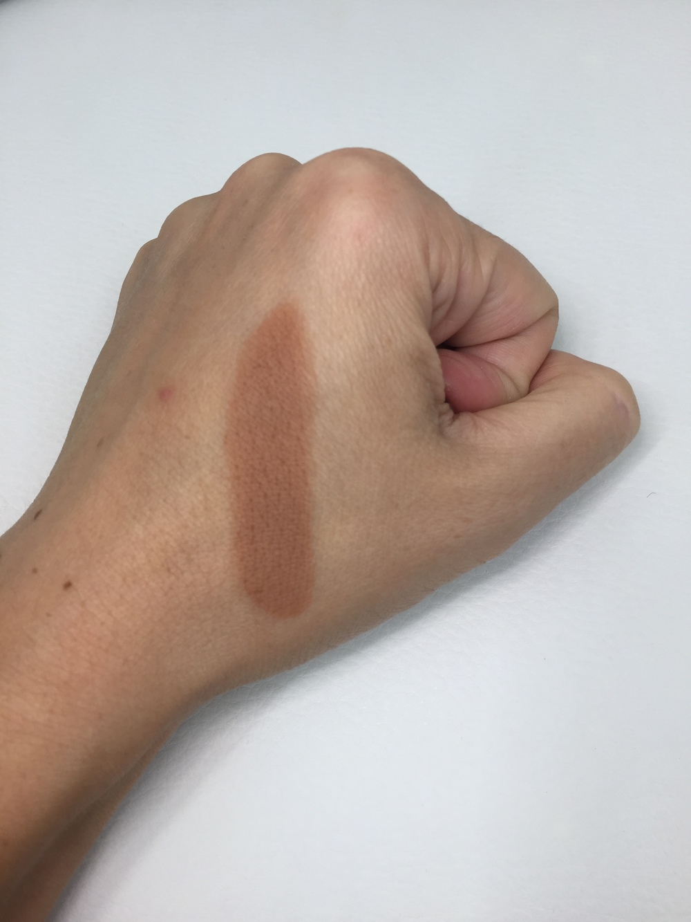 Too Faced The Little Black Book of Bronzers - Dark Chocolate Soleil Swatch