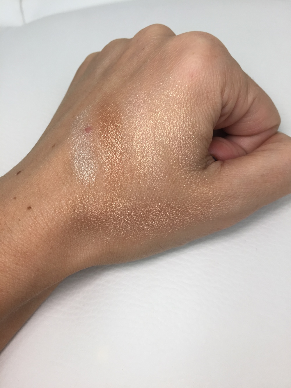 Too Faced The Little Black Book of Bronzers - Snow Bunny Swatch