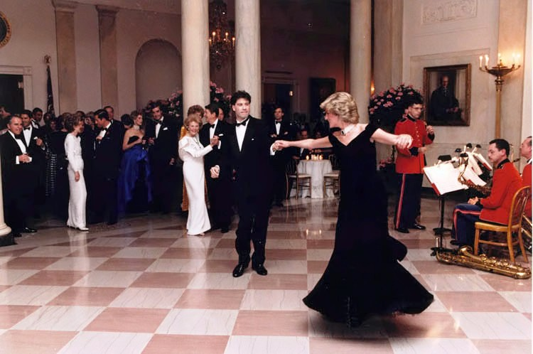 Princess Diana dances with John Travolta at The White House wearing one of the gowns in the exhibition at Kensington Palace